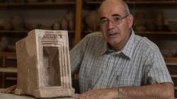 Yosef Garfinkel with a shrine model made of stone, found at Hirbet Qeiyafa (Courtesy Hebrew University of Jerusalem)