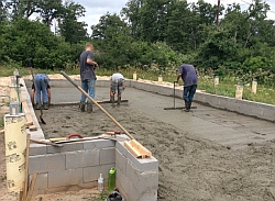 Spreading out the concrete.