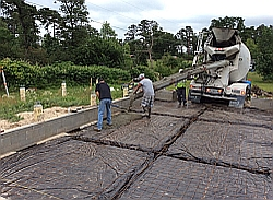 Putting the concrete in place.