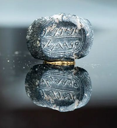 The bulla �(belonging) to Nathan-Melech, Servant of the King,� discovered March 31st, 2019 . (photo credit: ELIYAHU YANAI/CITY OF DAVID)