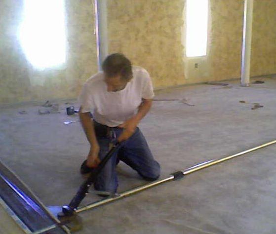 Tony laying carpet at Tsiyon