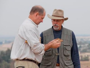Dr. Steven Collins, on the right, assessing a find